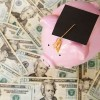Pig with mortar board and tassel on money