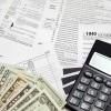Tax money with calculator